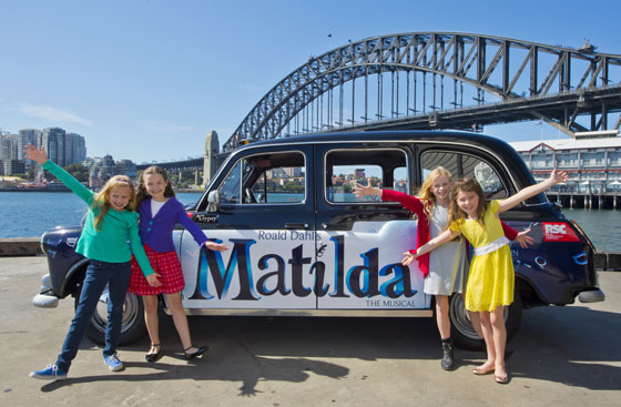 Australian Matildas with their London taxicab. Sydney Harbour bridge in the background. Photo by James Morgan