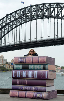 Tim atop the books at the Sydney Media Launch, October 2014 - Photo by James Morgan