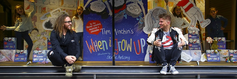 Tim & Steve sitting in the window of Waterstones Piccadilly at the London launch. Photo by Geoff Caddick/PA Wire